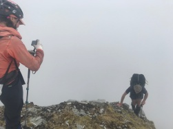 Jane gets a foggy snap of her partner, Geoff on top of the Goat Path, Franz Josef glacier in 2019